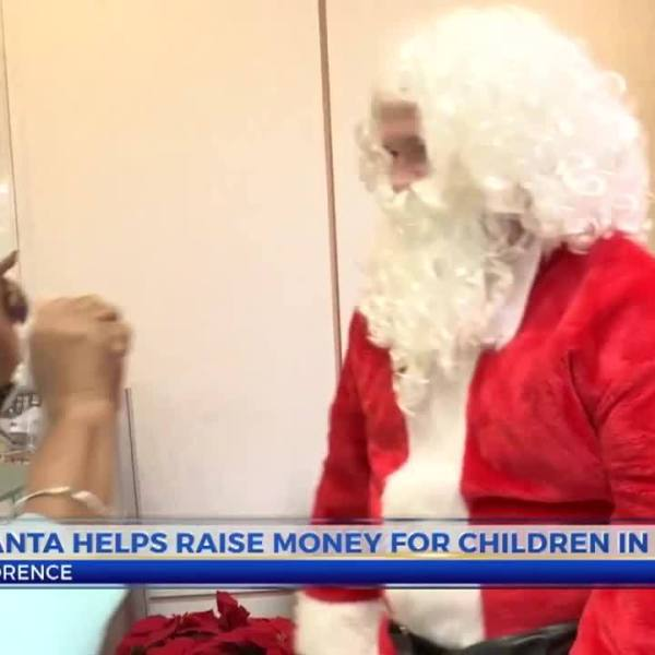 Florence_Santas_help_raise_money_for_hom_8_20181214041808