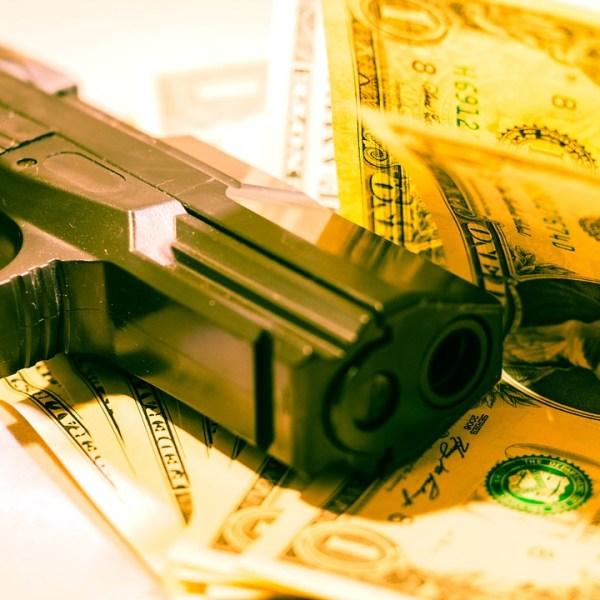 armed robbery money gun dollar crime.jpg