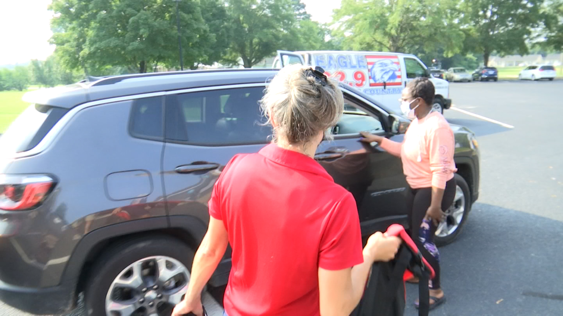 Florence students receive free school supplies at drive-through event
